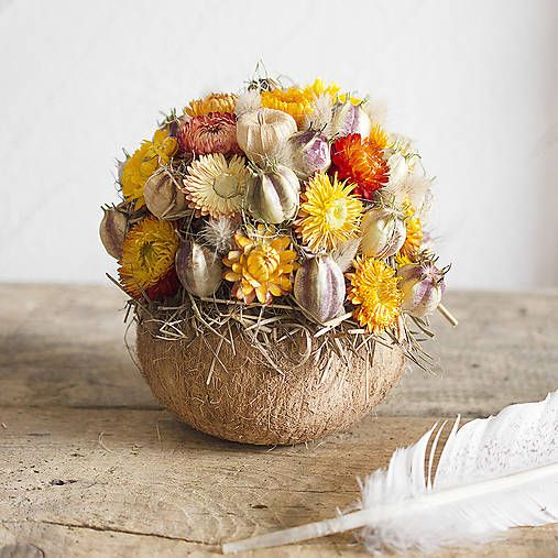 Floral bouquet in a coconut shell