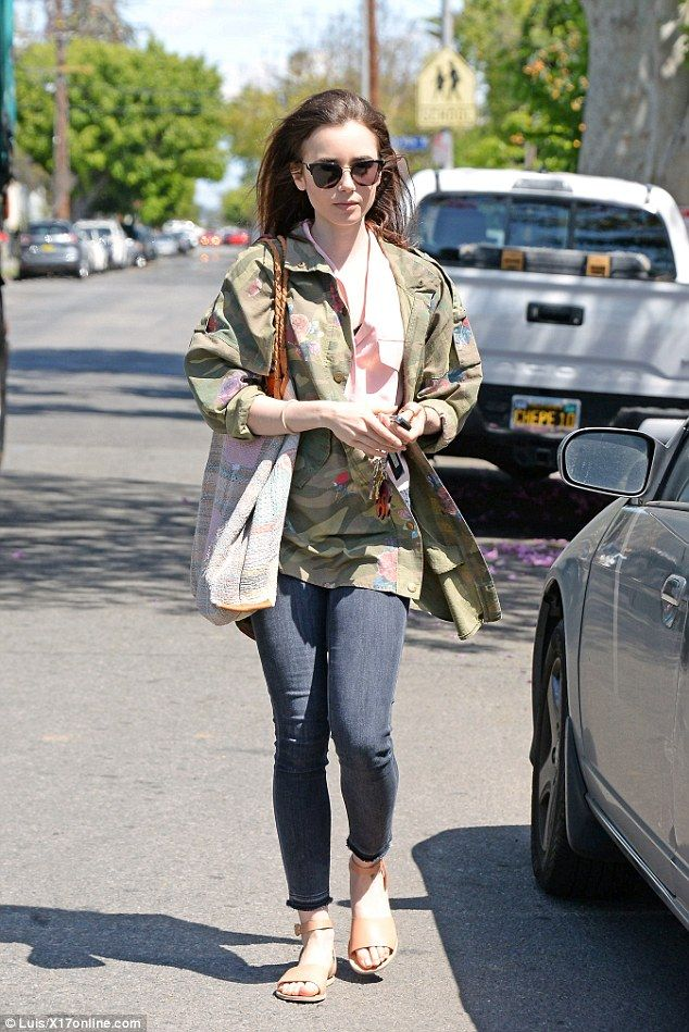 Arty: Lily Collins proved her love of words as she stepped out in West Hollywood on Friday...