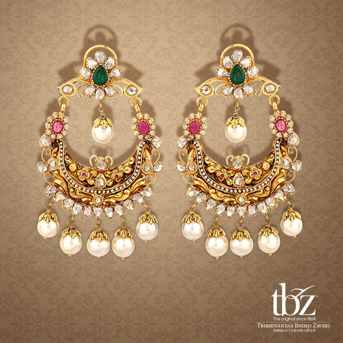Glittering Nakshi earrings with hints of emerald, kundan and pearls to compliment traditional attire in a flash.