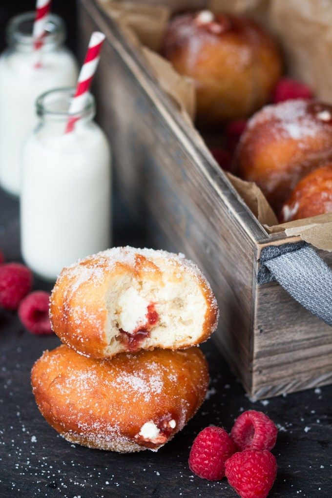 Raspberry Ripple Doughnuts - Golden brown, sugar dusted and served slightly warm - filled with raspberry jam and sweetened cream.  Irresistible!
