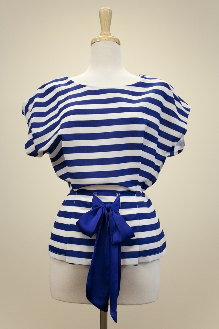 "Dressing Your Truth - Type 4 Yacht Club Top  "" This top is made of a close weave cloth for a sleek and structured fit. The straight cut is drawn in with pleats and tie for a flattering fit.""  in royal blue with white stripes."