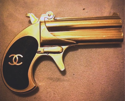 Coco Chanel Gun....I think this is definitely a NEED.  So apparently, to edit the coco quote, a girl should be three things: class, fabulous and ARMED.