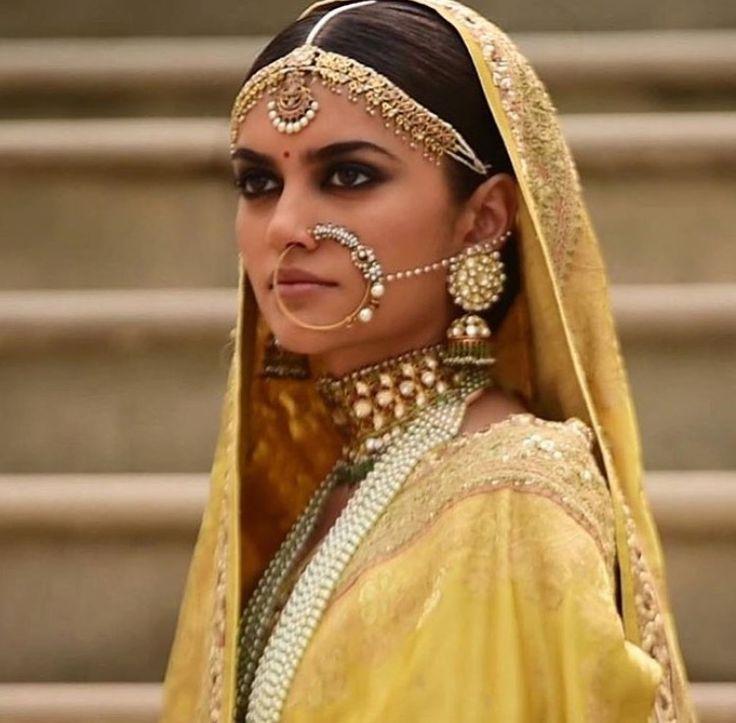 Indian bride wearing bridal lehenga and jewelry. Indian Bridal Hairstyle. Indian Bridal Makeup. Indian Bridal Fashion. Bridal Photoshoot. Nose ring. Maang tikka. Jhumkas.  Pinterest: @pawank90