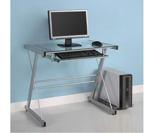 Glass Metal Computer Desk - This contemporary desk offers a sleek, modern design crafted from durable steel and thick, tempered safety glass. The size provides sufficient workspace with a look that is both attractive and simple. With its built-in sliding keyboard tray, this computer desk is both spacious and compact. A complimentary piece that is the perfect addition to any home office. Ships ready-to-assemble with necessary hardware and tools.