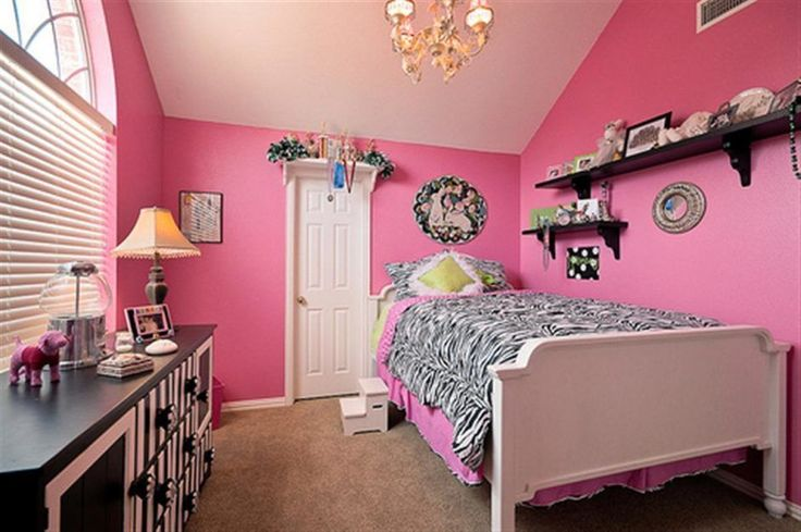 Feminine pink teen girls room design with zebra pattern bed sheet and single size bed frame. #ZebraPrintBedding