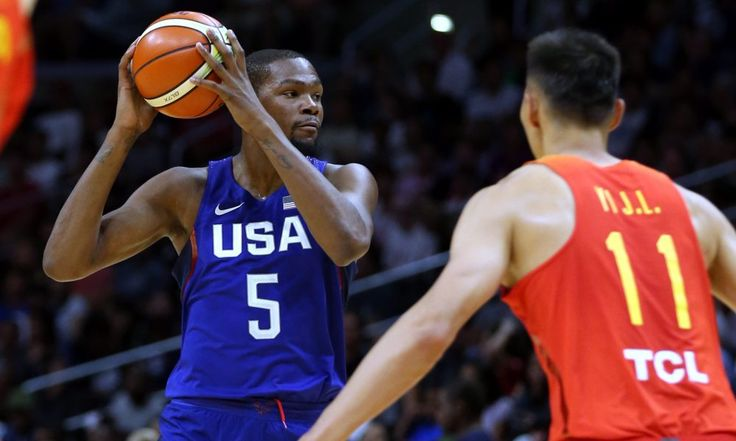epa05439822 USA player Kevin Durant (L) looks to pass the ball as he is defended by  Chinese player Yi Jianlian (R) during the first half of an exhibition game at Staples Center in Los Angeles, California, USA, 24 July 2016. The US team is playing  five exhibition matches before heading to the Olympic Games in Brazil.  EPA/MIKE NELSON ORG XMIT: MAN25