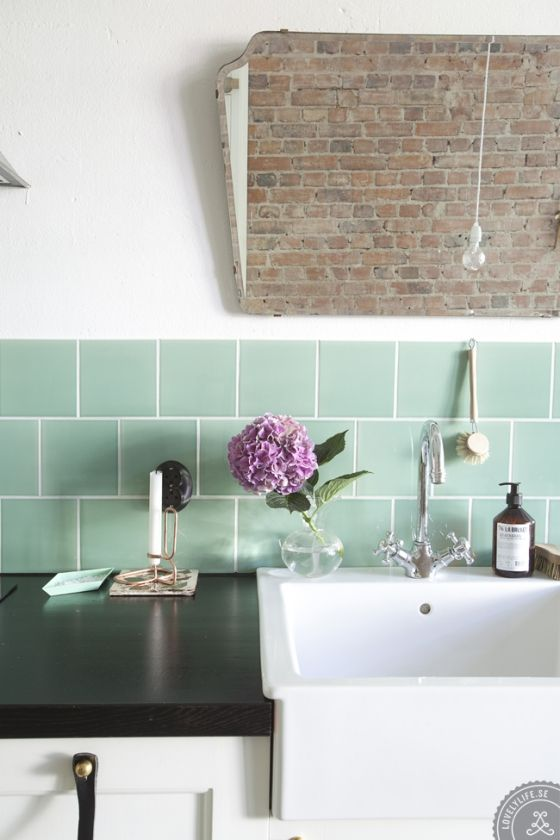 #ScandinavianKitchen with a #FarmhouseSink and the perfect green tile from Lovely Life
