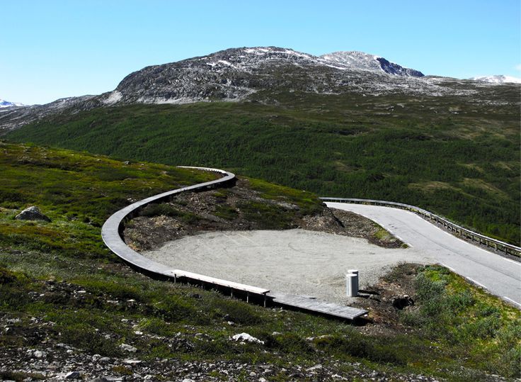 norwegian firm LJB arkitektur have constructed a floating concrete path and accompanying wooden bench for a lookout point at vedahaugane, norway.