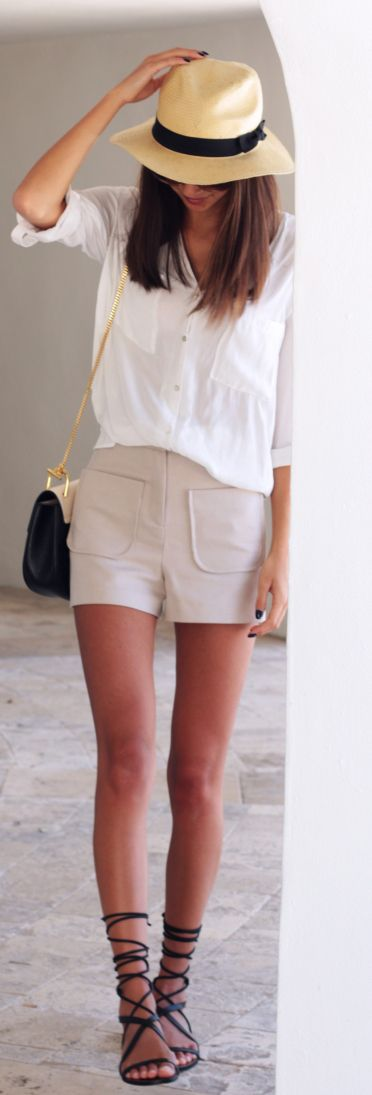 Neutral Outfit Ideas: Felicia Akerstrom is wearing a pair of Topshop beige shorts with a white shirt