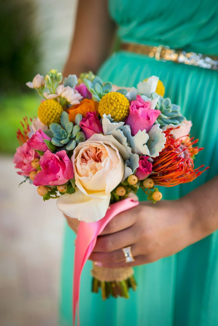 To make your botanical garden wedding a bright and brilliant day, try a colorful floral arrangement like this for your bridal party's bouquets! A bright bridesmaid dress will also make these flowers POP in photos... perfect for a spring wedding.