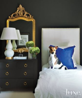 A Houston French Revival's guest #bedroom is painted #matte charcoal. | See MORE at www.luxesource.com. | #luxemag #interiordesign #design #interiors #homedecor: