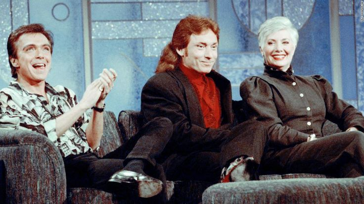 """Former Partridge Family cast members David Cassidy, left, Danny Bonaduce and Shirley Jones reunite on the """"The Arsenio Hall Show"""" in July 1993. It was the first time the three had appeared together since the popular 1970s series left the air. Cassidy performed """"I Think I Love You"""" during the taping."""