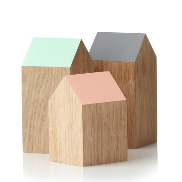 Wooden houses with pastel colored roof