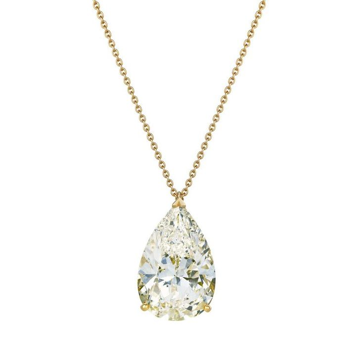 A classic yellow gold pendant set with a pear-shaped 24.71ct M-colour white diamond from De Beers' Master Diamonds 1888 collection. Discover the truth about colour graded yellow or white diamond engagement rings: http://www.thejewelleryeditor.com/bridal/surprising-alternative-yellow-diamonds/ #jewelry