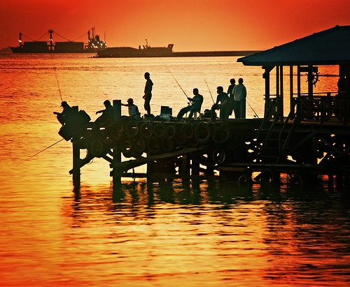 Fishing by the dock, Losari Beach, South Sulawesi, Indonesia.  (by moriza)