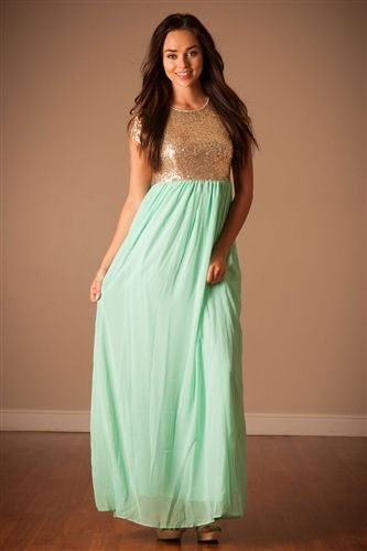 The Elsa features a short sleeve, round neckline bodice that is covered in tiny gold sequins and followed by a long Mint chiffon maxi skirt. Dress is fully lined with back zipper closure.