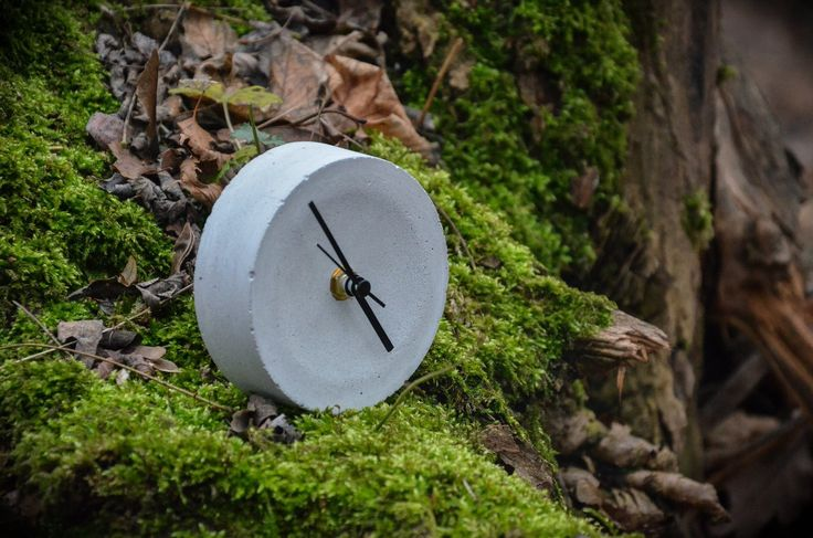 round clock by &concrete