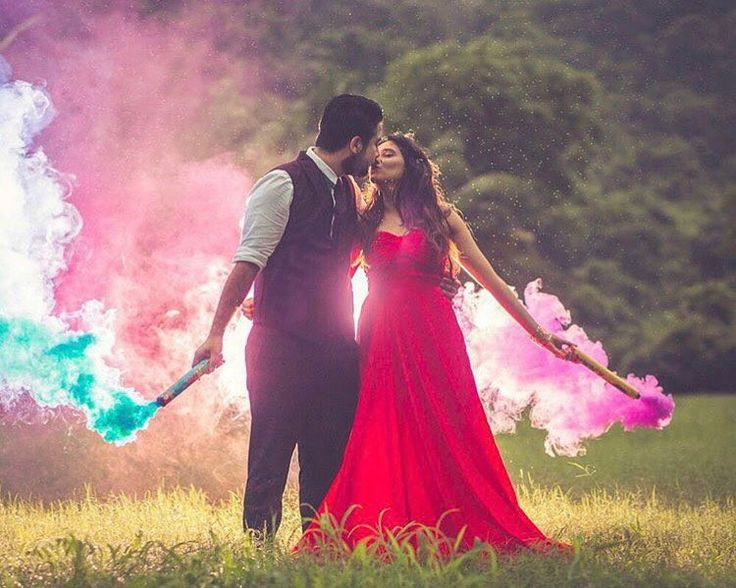 These colour bombs are just extras to add in their love! #Trending, #TrendingPhotos, #PreWeddingShoot, #PreWeddingShootIdeas, #MustHaveShots, #CoupleShoot, #UniquePhotoIdeas #indianweddings #indianbrides #shaadisaga