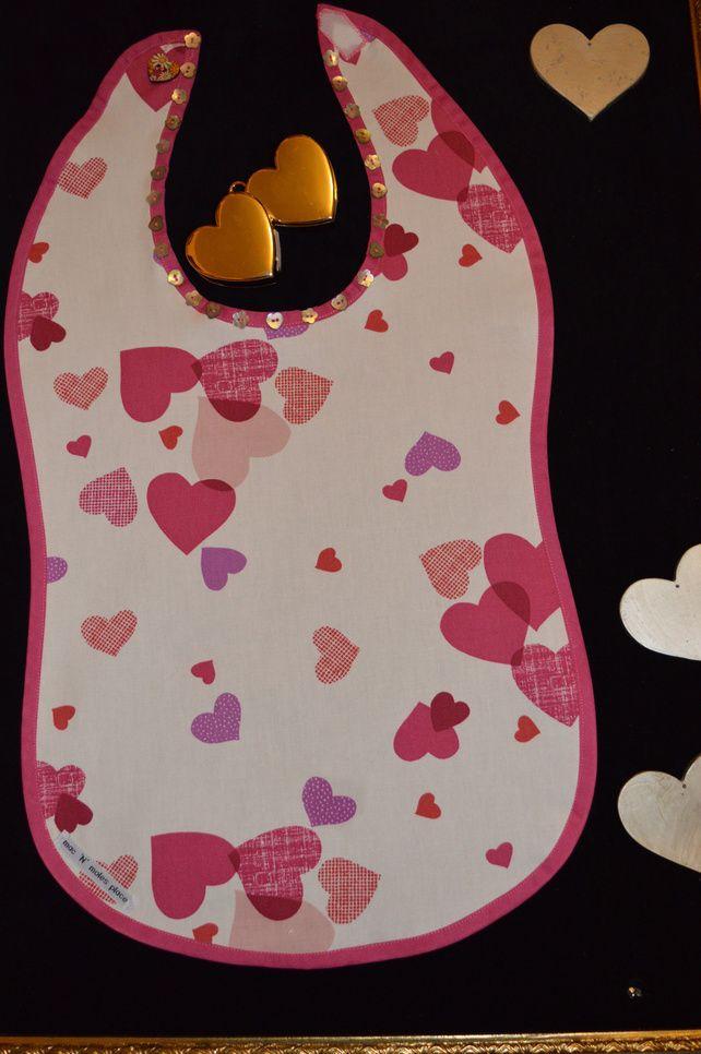 Valentine's adult pasta bib in John Lewis'Hearts' fabric.Heart button detail     £16.49