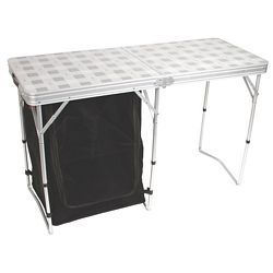 On your next camping trip or picnic, take your pantry along with your table when you bring along a Coleman Store More Cupboard Table. Under this sturdy full-size table hangs a collapsible, soft cupboard, giving you a place to store your dishes, food, or