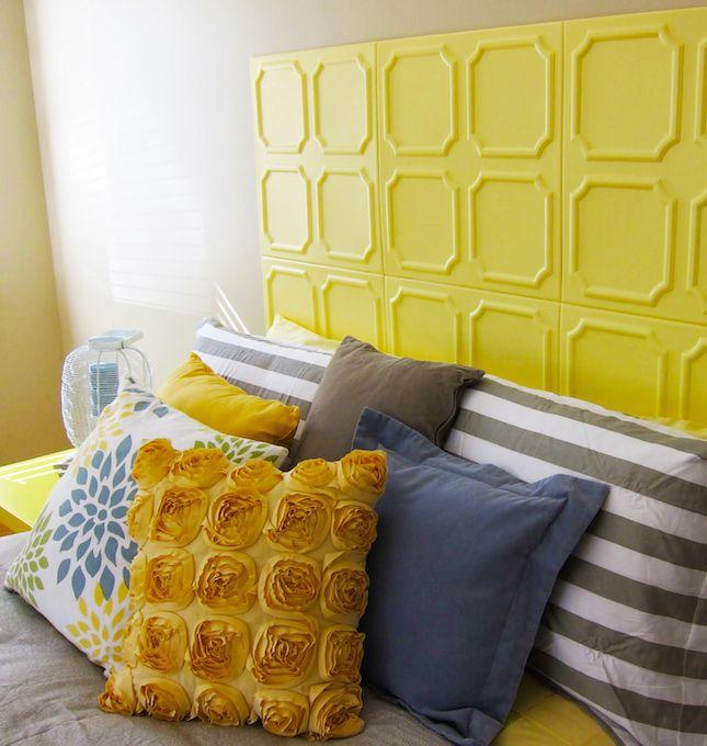 DIY a sunny yellow headboard using styrofoam ceiling tiles.