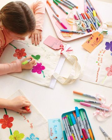 create a tote bag using iron-on flower clip art or puffy paint.