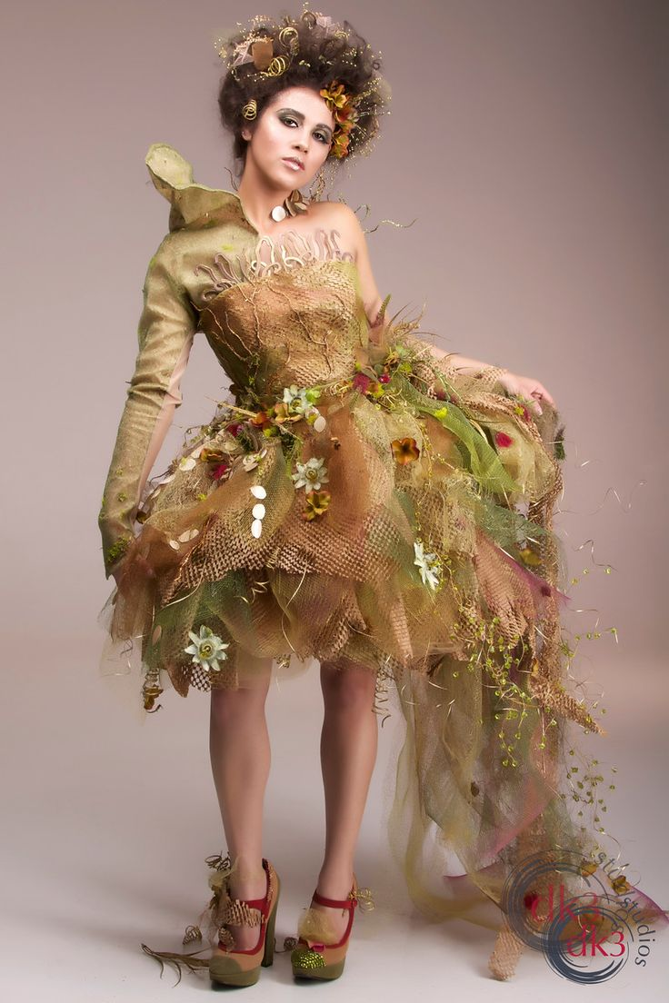 """""""made of eco packing paper, food containers, and leaves and stems all made out of plastic. There's also some scrap silk and tulle as the base"""""""