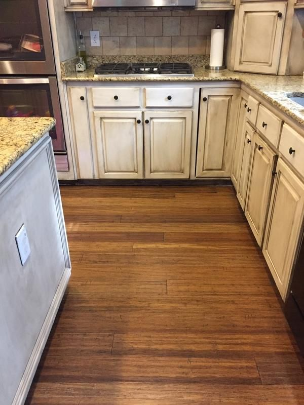 Distressed Floors Add Charm To This Kitchen Remodel
