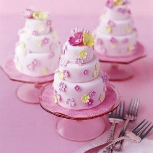 Cute, delicate, fun, and tiny individual mini wedding cakes in a palette of pink and yellow