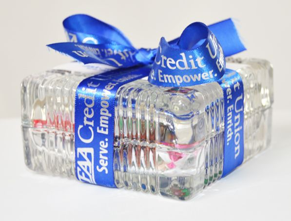 """A candy dish with the company logo topped off with custom ribbon? What a """"sweet"""" way to celebrate your brand!"""