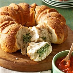 Spinach Dip Pull-Aparts Recipe -Even picky eaters who don't like to eat spinach will dig into these tasty little bites. — Kelly Williams, Forked River, New Jersey