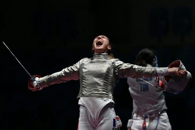 France's Manon Brunet celebrates winning against Tunisia's Azza Besbes…