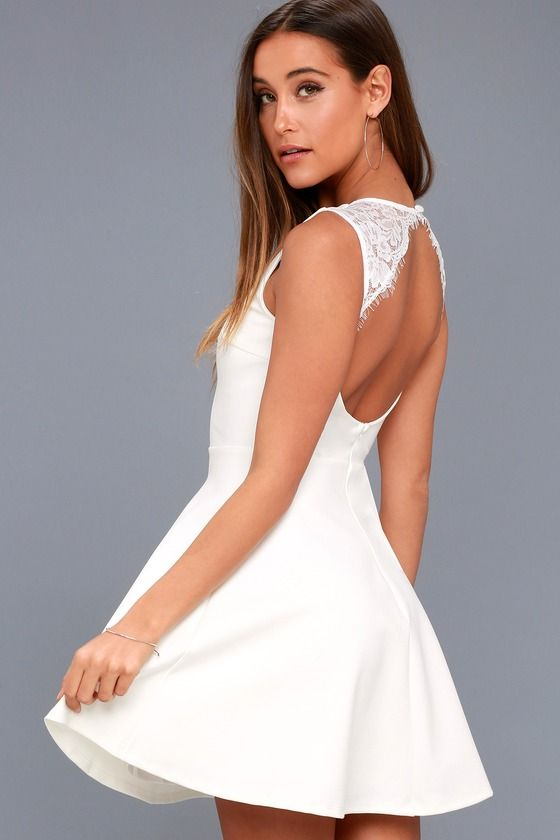 4c4c391c83fa A party perfect look is at your fingertips with the Need You Close White  Lace Backless Skater Dress! Stretch knit fabric shapes a rounded neckline,  ...