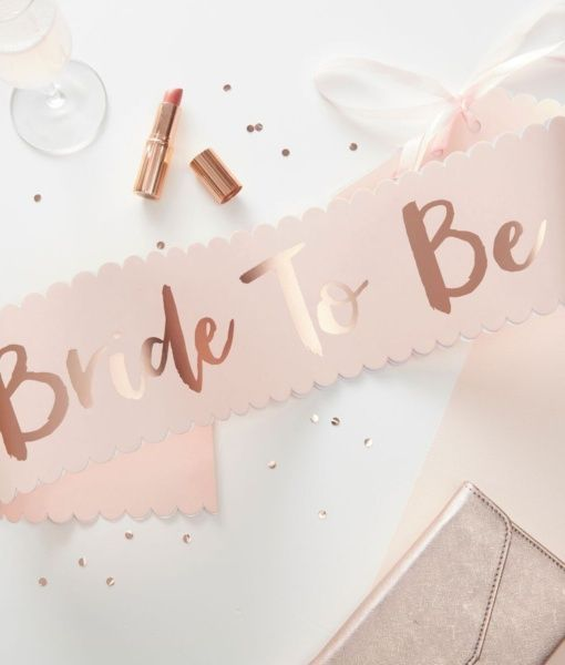 This gorgeous pink and rose gold bride to be sash is a super stylish accessory for a classy and chic hen party. Available now at thehenplanner.com #hen #party #sash #chic #classy #pink #gold #bride #to #be #bridal #shower #hens #night