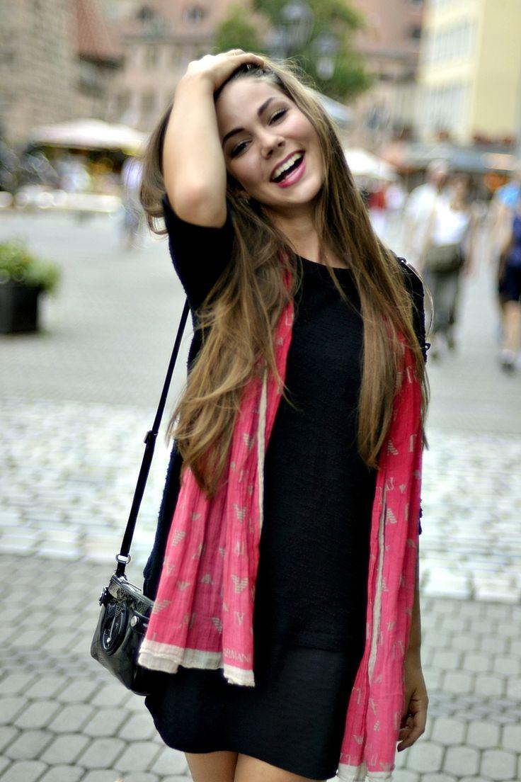 pink scarf, black dress, gold, bag