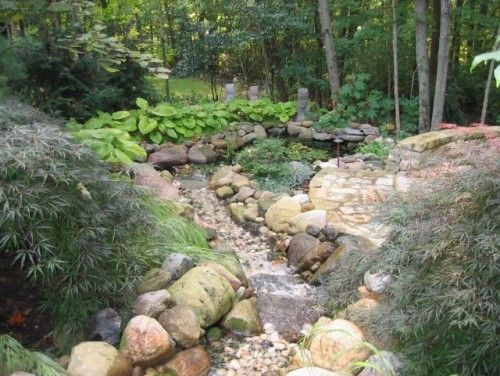 Dry Riverbeds Solve Water Runoff  Spring rains don't have to lead to slides. Dry riverbeds redirect water runoff and add beauty to your landscape