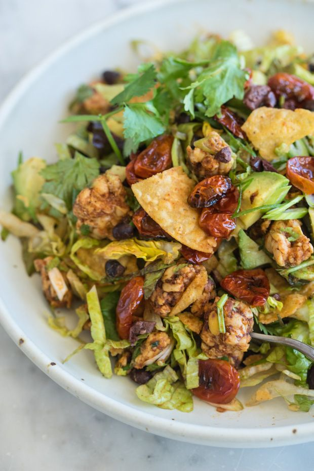 Vegan Tempeh Taco Salad - All the things you love about a taco, in salad form. Crushed tortilla chips bring the crunch, black beans and crumbled tempeh coated with taco seasoning brings the substance, and a strong, smoked paprika-apple cider dressing pulls everything together.