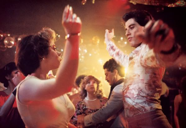 John Travolta - Saturday Night Fever (1977) love her hair style !!