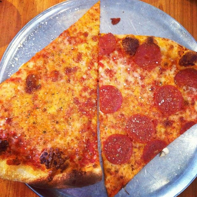 Check Out Pizza Delicious in New Orleans, LA as seen on Man Finds Food and featured on TVFoodMaps. Known for Garlic Knot-chos