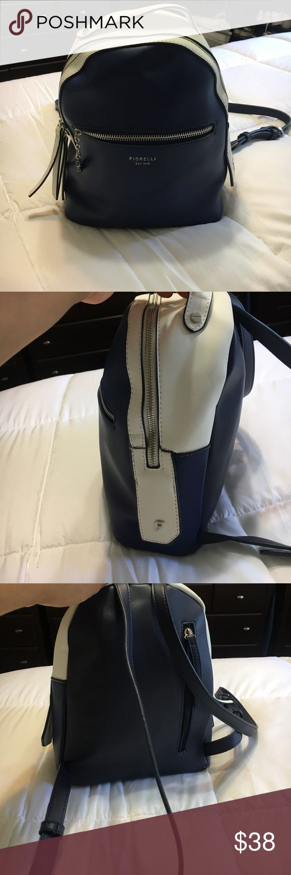 """Like new Fiorelli backpack purse Like new, blue and white backpack purse, measurements are 12""""11""""4 1/2..strap drop is 30 inches and can be made shorter or longer Giorgio Fiorelli Bags Backpacks"""