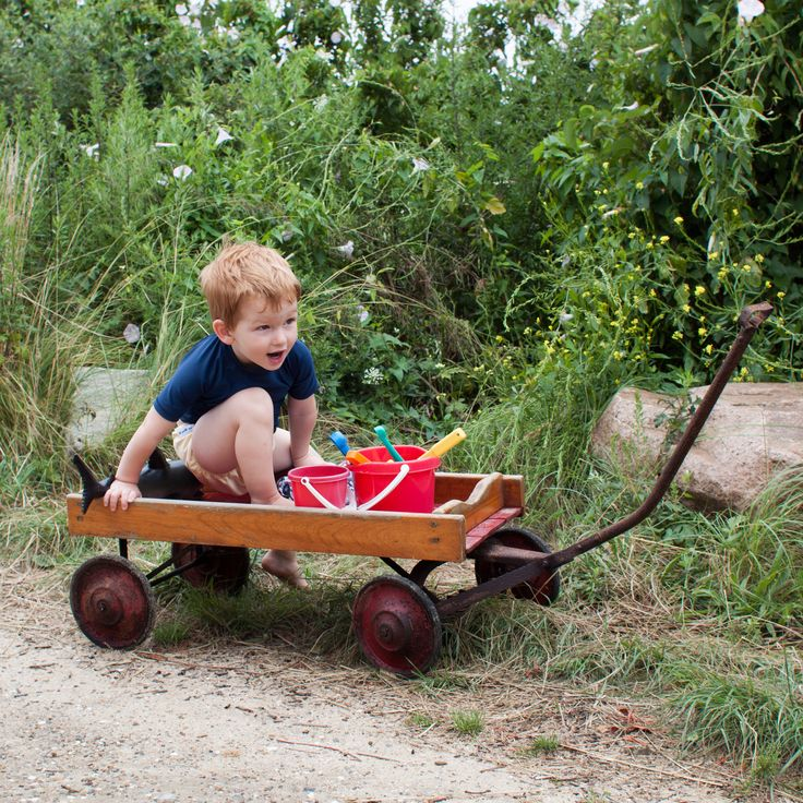 https://flic.kr/p/cJ2B4S | Little Red Wagon [211/366] | Day 211.  Our fourth day on Nantucket: my parents found and cleaned up this old red wagon from my childhood or possibly even older for Isaac to play with in Nantucket. He thought it was just about the best thing ever, and had a blast riding in it down the dirt lane to the beach.   Taken Jul 29, 2012 in Nantucket, Massachusetts, United States ¹⁄₃₂₀ sec at f/6.3, ISO200, no flash. Lens: EF28mm f/1.8 USM @ 28 mm