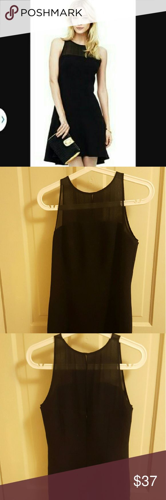 Last day--Club Monaco Lorna Dress Size 6, true to size. Never worn, in perfect condition. Scuba material with sheer top and flounce bottom. The perfect little black dress. Club Monaco Dresses Midi