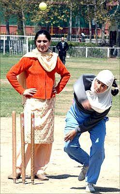 Wow! Give it all.  Kashmiri_Girls_playing_cricket
