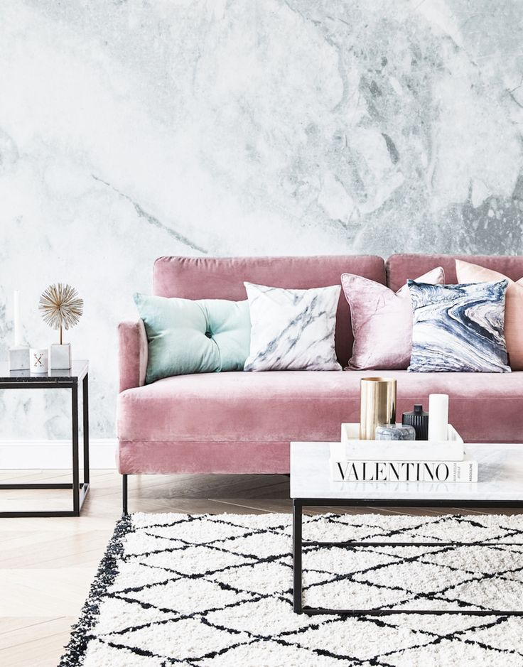 A pink sofa adds elegant whimsy to any living room decor.