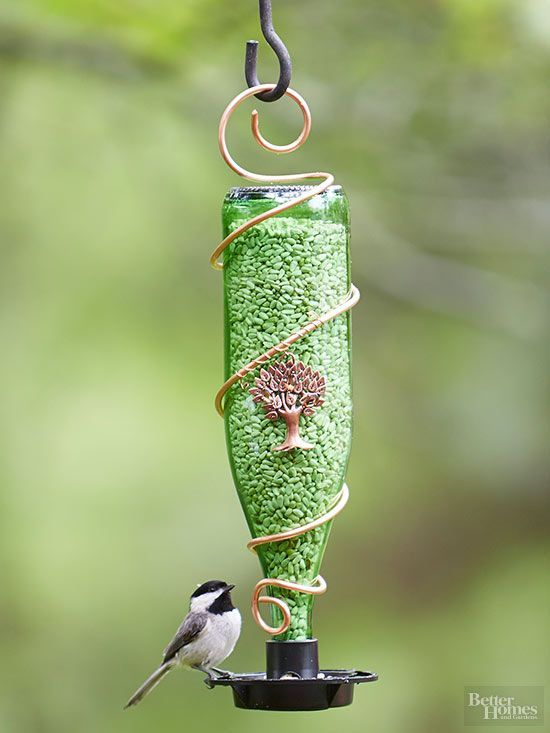 Save the Earth, feed the birds, and create a cute garden accessory all in one fun and easy DIY project! Use a recycled glass bottle, copper wire, a feeder attachment, and a cute ornamental charm to create a pretty bird feeder. Then, fill with seeds to bring the birds to your yard!