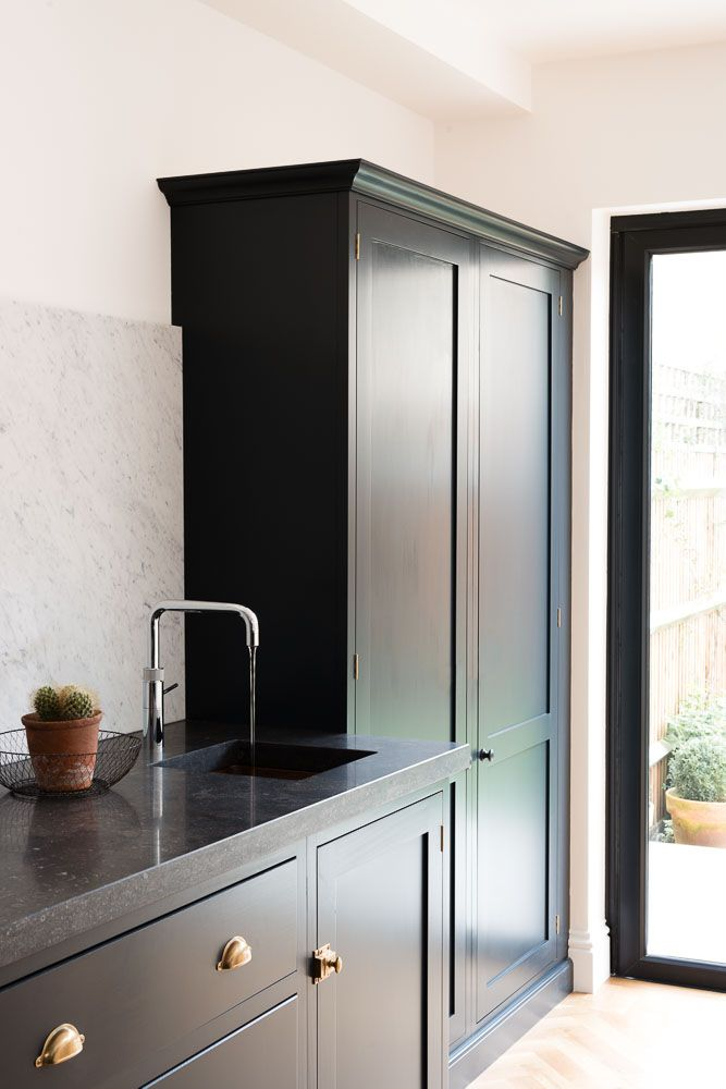 Kitchen by DeVol. Love how the pantry looks like an elegant free-standing piece of furniture