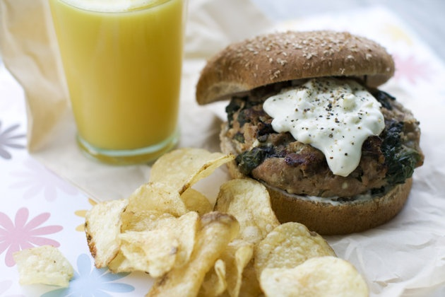 A Greek-style turkey burger with pepperoncini sauce can be juicy and flavorful. (AP Photo/Matthew Mead)