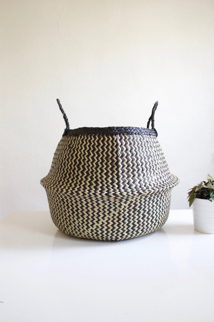 Large black and natural hand woven seagrass basket. Each basket is woven by people of a small village in Vietnam, near the hometown of the woman behind Xinh & Co., the importer of the baskets. Each ba