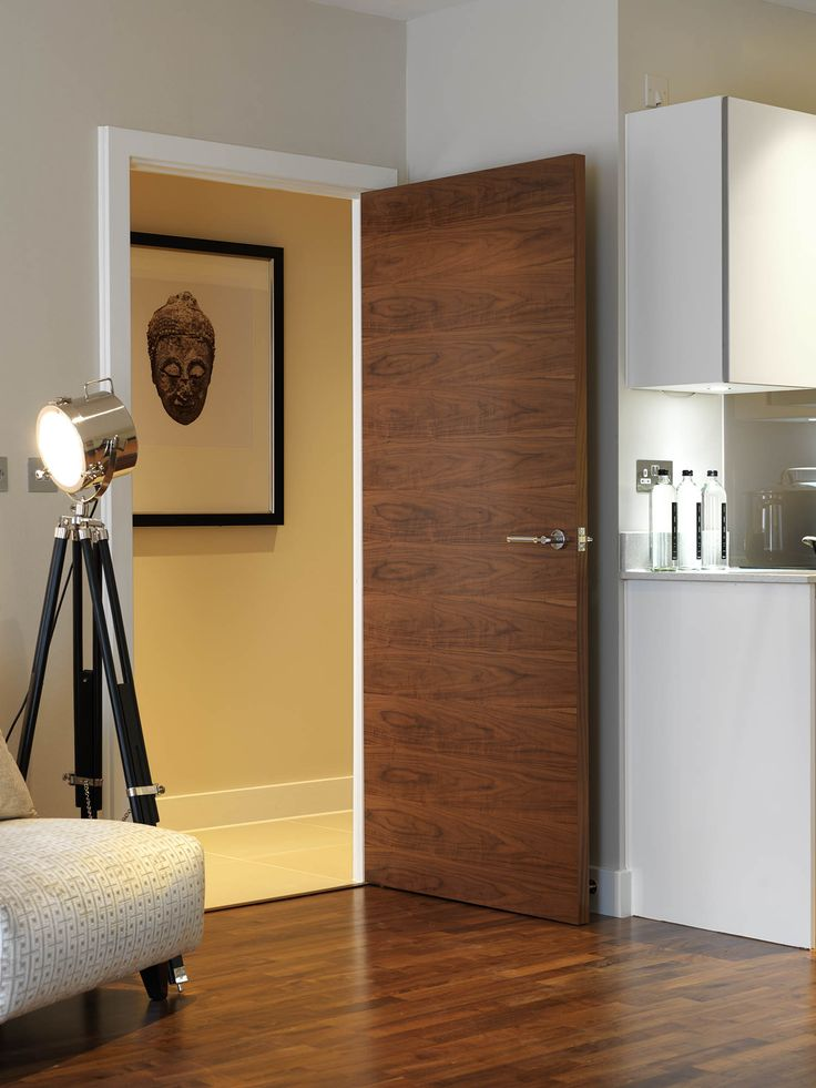 #walnutdoors are very on trend.  The beautiful flush veneer matches the contemporary interior perfectly.  JB Kind's Walnut Flush Fernor door.