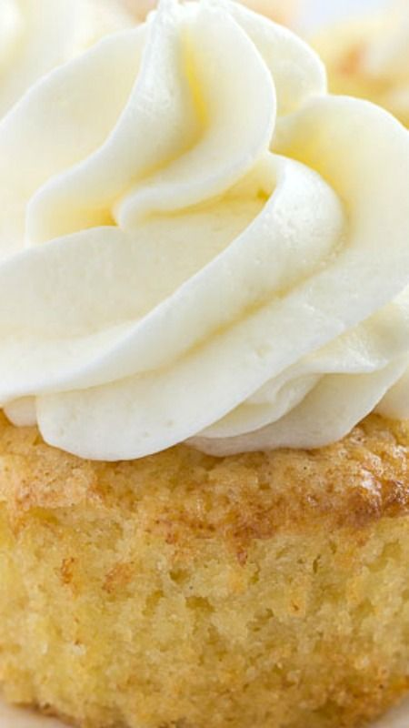 Ppineapple Cupcakes ~ Moist, buttery, and loaded with crushed pineapple... They are paired perfectly with coconut buttercream for a tropical treat.
